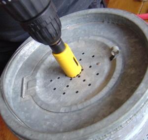Drill_on_lid_of_minno_bucket_liner